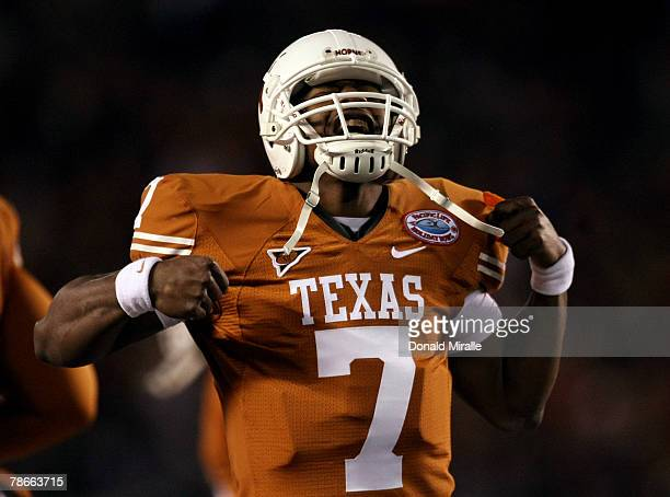 Quarterback John Chiles of the Texas Longhorns celebrates after scoring a rushing touchdown against the Arizona State Sun Devils during the 1st half...