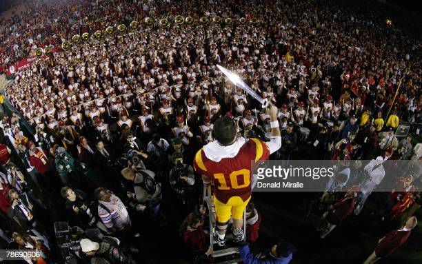 Quarterback John David Booty of the USC Trojans conducts the band after defeating the Illinois Fighting Illini in the Rose Bowl presented by Citi at...