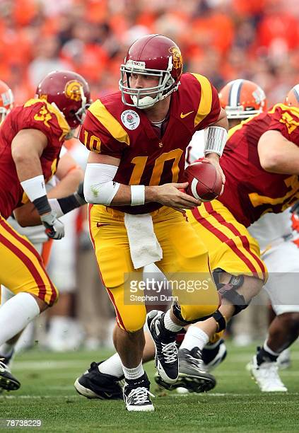 Quarterback John David Booty of the USC Trojans looks to hand off the ball against the Illinois Fighting Illini during the Rose Bowl presented by...