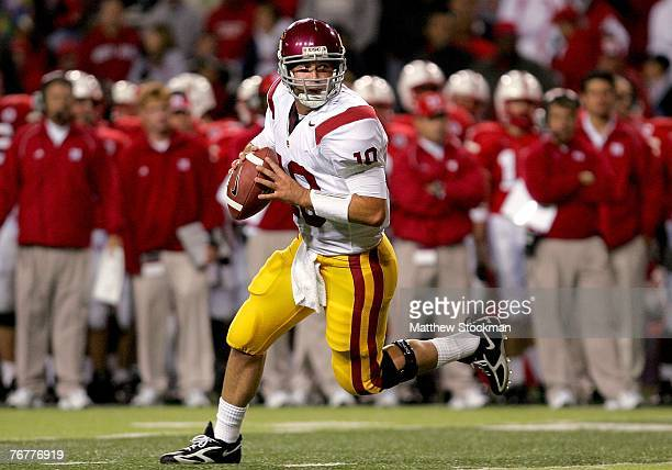 Quarterback John David Booty of the USC Trojans rolls out of the pocket against the Nebraska Cornhuskers on September 15 2007 at Memorial Stadium in...