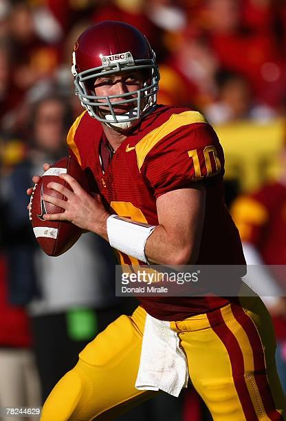 Quarterback John David Booty of the USC Trojans scrambles to pass during the college football game against the UCLA Bruins at the Los Angeles...