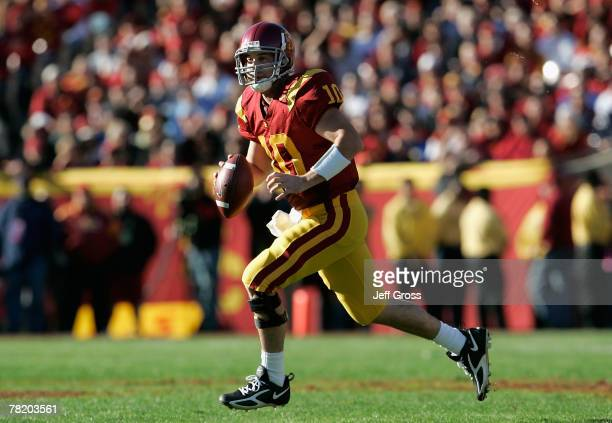 Quarterback John David Booty of the USC Trojans scrambles with the ball during the college football game against the UCLA Bruins at the Los Angeles...