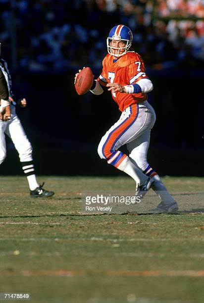 Quarterback John Elway of the Denver Broncos drops back to pass in an undated photo during a game at Mile High Stadium in Denver Colorado Elway...