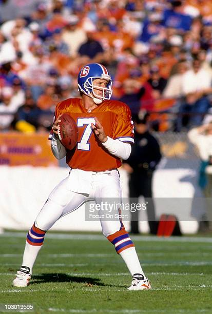 Quarterback John Elway of the Denver Broncos drops back to pass against the Seattle Seahawks December 1 1996 during an NFL football game at Mile High...