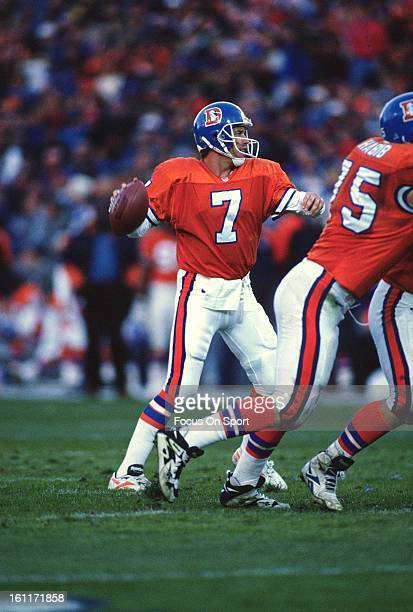 Quarterback John Elway of the Denver Broncos drops back to pass against the Seattle Seahawks during an NFL football game December 1 1996 at Mile High...