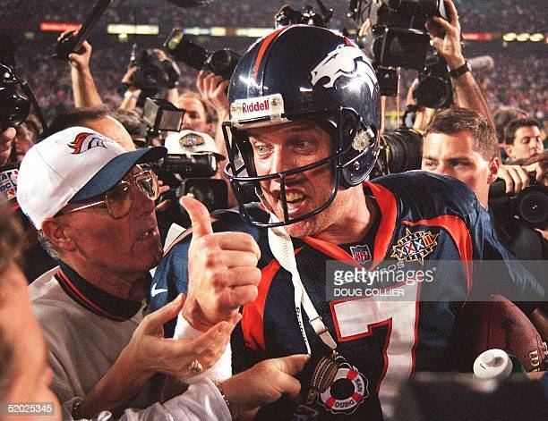 Quarterback John Elway of the Denver Broncos gives the thumbs up after the Broncos defeated the Green Bay Packers 31-24 to win Super Bowl XXXII on...