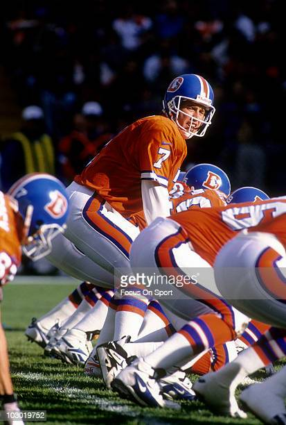 Quarterback John Elway of the Denver Broncos is under center calling signals against the Seattle Seahawks December 1 1996 during an NFL football game...