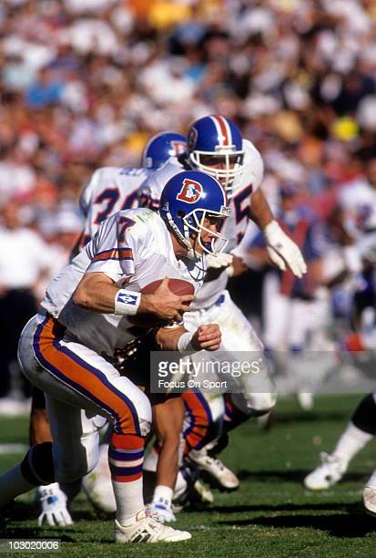 Quarterback John Elway of the Denver Broncos runs with the ball against the San Diego Chargers September 12 1993 during an NFL football game at Jack...