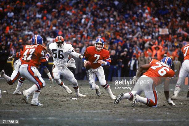 Quarterback John Elway of the Denver Broncos runs with the ball during the 1986 AFC Championship Game against the Cleveland Browns at Municipal...
