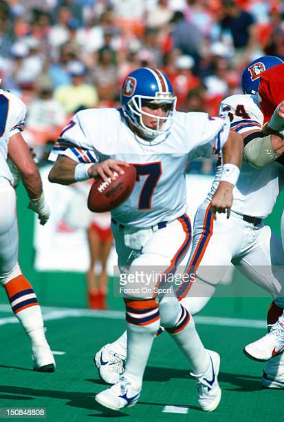 Quarterback John Elway of the Denver Broncos scrambles away from the rush against the Kansas City Chiefs during an NFL football game October 27 1985...