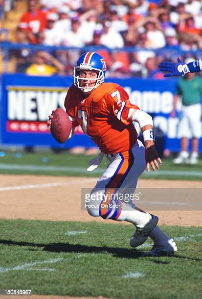 Quarterback John Elway of the Denver Broncos scrambles away from the rush against the Indianapolis Colts during an NFL football game October 3 1993...