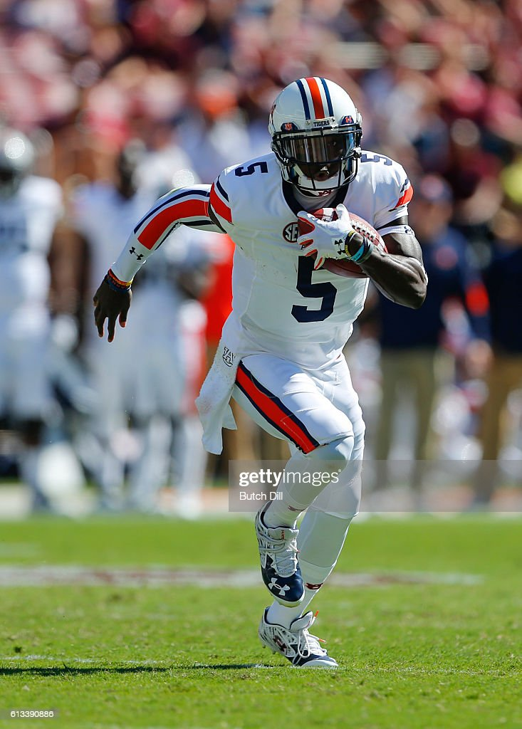 Quarterback John Franklin III #5 of the Auburn Tigers scrambles for yardage against the Mississippi State Bulldogs during the second half of an NCAA college football game on October 8, 2016 in Starkville, Mississippi.