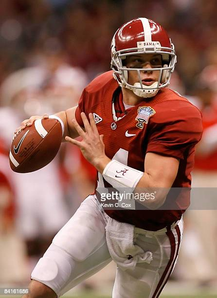 Quarterback John Parker Wilson of the Alabama Crimson Tide rolls out of the pocket in the second quarter while taking on the Utah Utes during the...
