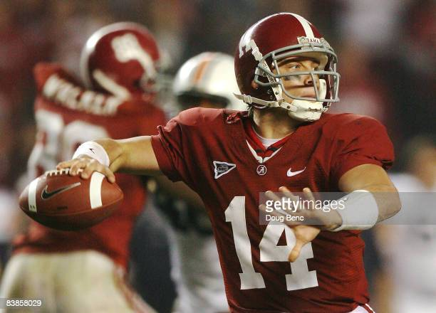 Quarterback John Parker Wilson of the Alabama Crimson Tide throws a pass against the Auburn Tigers at BryantDenny Stadium on November 29 2008 in...