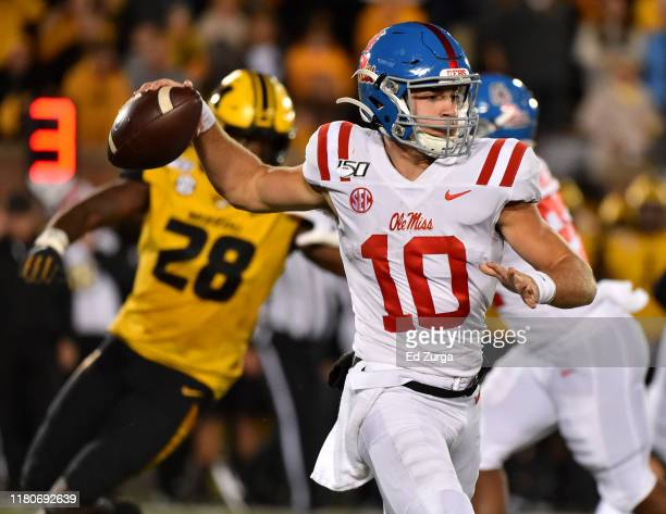 Quarterback John Rhys Plumlee of the Mississippi Rebels passes against the Missouri Tigers in the second quarter at Faurot Field/Memorial Stadium on...