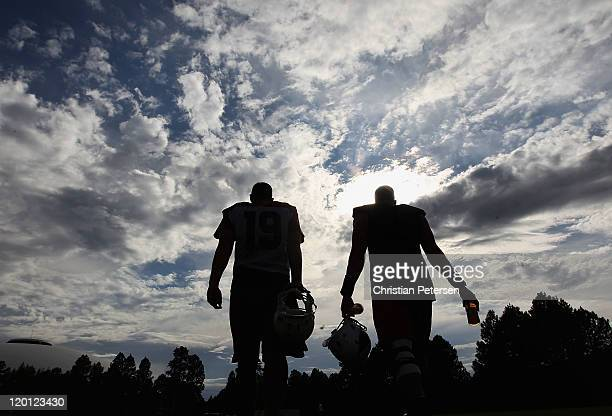 Quarterback John Skelton and tight end Jim Dray of the Arizona Cardinals walk off the field following the team training camp at Northern Arizona...