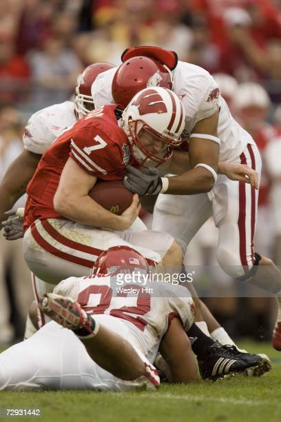 Quarterback John Stocco of the Wisconsin Badgers is sacked by the defense during a game against the Arkansas Razorbacks in the Capital One Bowl at...