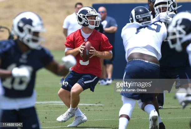 Quarterback John Wolford of the Los Angeles Rams runs drills during minicamp at the team's practice facility at California Lutheran University on...