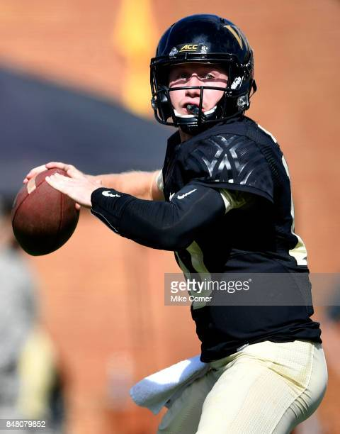 Quarterback John Wolford of the Wake Forest Demon Deacons drops back to pass against the Utah State Aggies during the football game at BBT Field on...