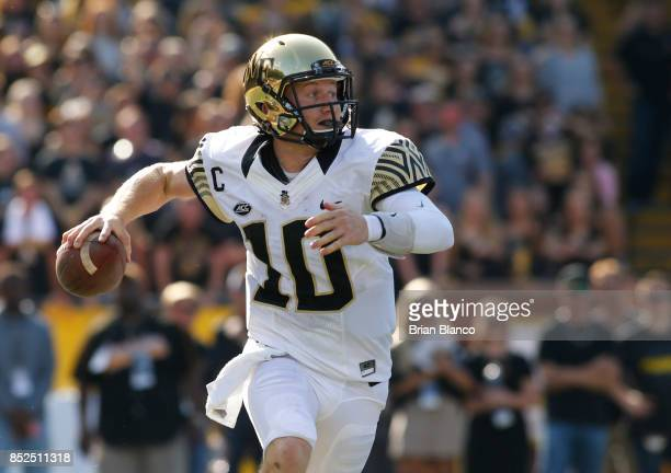 Quarterback John Wolford of the Wake Forest Demon Deacons looks for an open receiver during the first quarter of an NCAA football game against the...