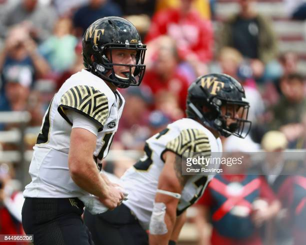 Quarterback John Wolford of the Wake Forest Demon Deacons looks on during the game against the Boston College Eagles at Alumni Stadium on September 9...