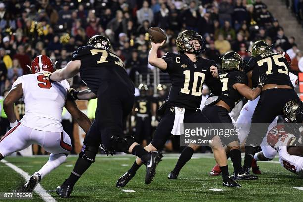 Quarterback John Wolford of the Wake Forest Demon Deacons makes a pass attempt against the North Carolina State Wolfpack during the game at BBT Field...