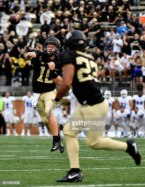 Quarterback John Wolford of the Wake Forest Demon Deacons makes a pass to running back Matt Colburn of the Wake Forest Demon Deacons during the...