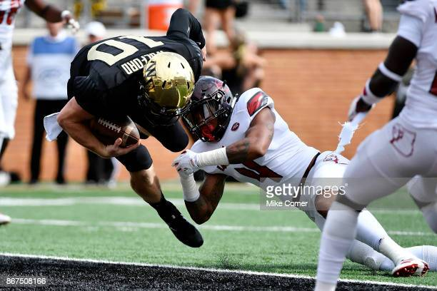 Quarterback John Wolford of the Wake Forest Demon Deacons rushes for a touchdown against the Louisville Cardinals in the first quarter at BBT Field...