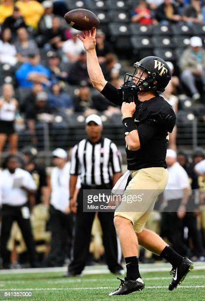 Quarterback John Wolford of the Wake Forest Demon Deacons throws for a touchdown against the Presbyterian Blue Hose at BBT Field on August 31 2017 in...