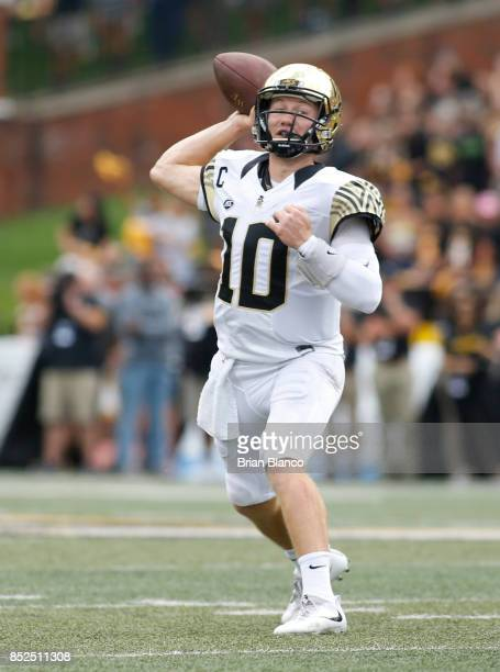 Quarterback John Wolford of the Wake Forest Demon Deacons throws to an open receiver during the first quarter of an NCAA football game against the...