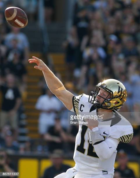 Quarterback John Wolford of the Wake Forest Demon Deacons throws to an open receiver during the second quarter of an NCAA football game against the...