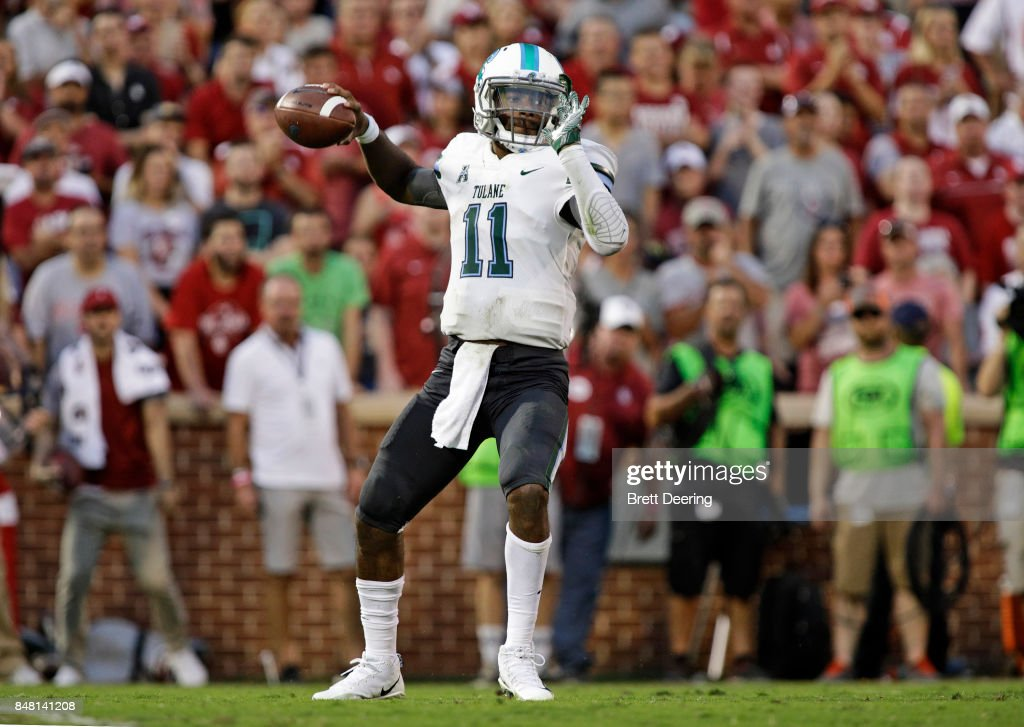Quarterback Johnathan Brantley #11 of the Tulane Green Wave looks to throw against the Oklahoma Sooners at Gaylord Family Oklahoma Memorial Stadium on September 16, 2017 in Norman, Oklahoma. Oklahoma defeated Tulane 56-14.