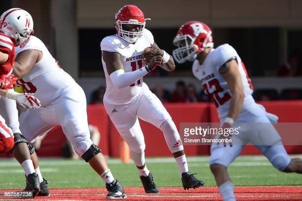 Quarterback Johnathan Lewis of the Rutgers Scarlet Knights runs against the Nebraska Cornhuskers at Memorial Stadium on September 23 2017 in Lincoln...