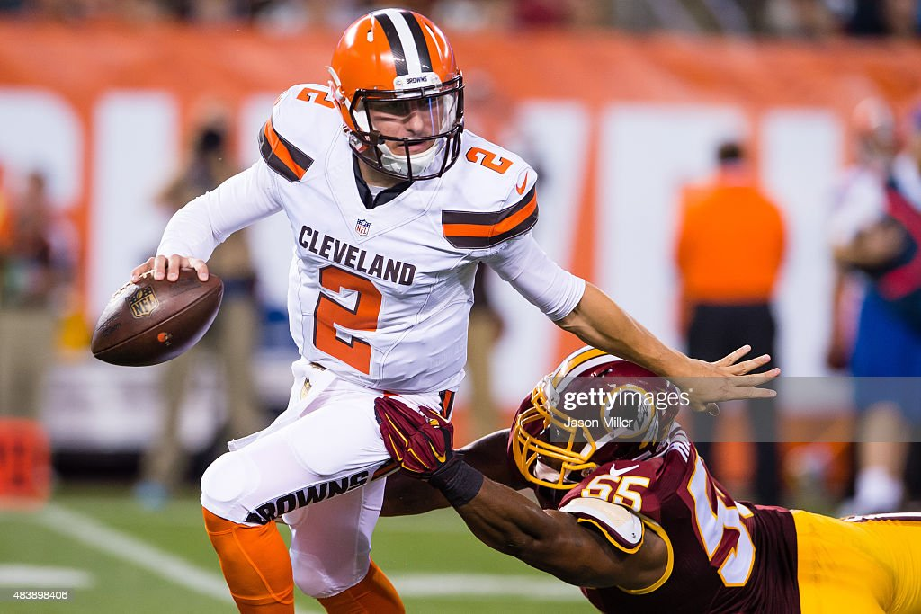 Quarterback Johnny Manziel #2 of the Cleveland Browns brushes off a tackle by outside linebacker Adam Hayward #55 of the Washington Redskins during the first half at FirstEnergy Stadium on August 13, 2015 in Cleveland, Ohio.