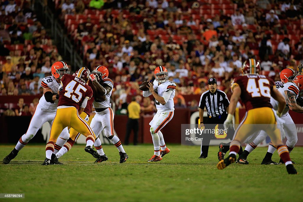 Quarterback Johnny Manziel #2 of the Cleveland Browns drops back to pass against the Washington Redskins during a preseason game at FedExField on August 18, 2014 in Landover, Maryland.