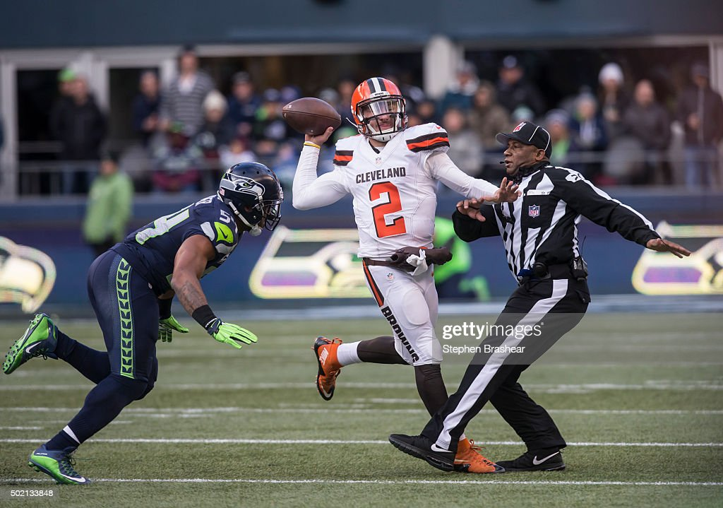 Quarterback Johnny Manziel #2 of the Cleveland Browns passes the ball as he runs into umpire Barry Anderson, right, while linebacker Bobby Wagner #54 of the Seattle Seahawks puts on the pressure during the second half of a football game at CenturyLink Field on December 20, 2015 in Seattle, Washington. The Seahawks won the game 30-13.