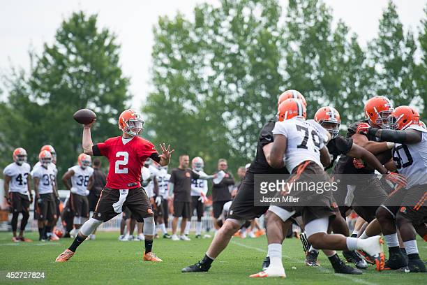 Quarterback Johnny Manziel of the Cleveland Browns runs a play during training camp at the Cleveland Browns training facility on July 26 2014 in...