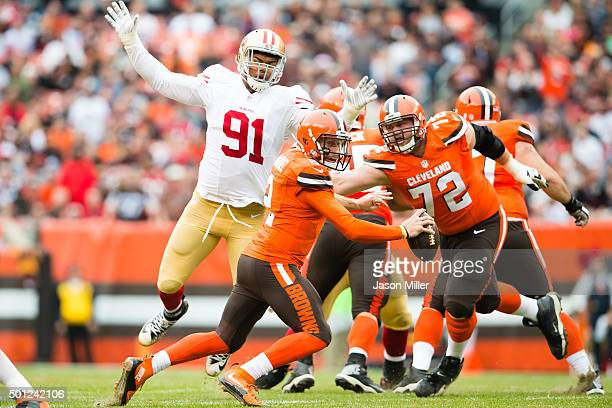 Quarterback Johnny Manziel of the Cleveland Browns scrambles while under pressure from defensive end Arik Armstead of the San Francisco 49ers during...