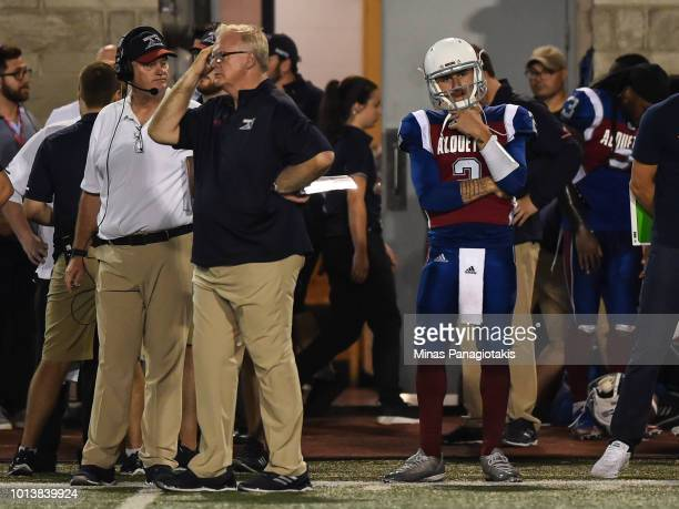 Quarterback Johnny Manziel of the Montreal Alouettes and head coach Mike Sherman look on from the sidelines against the Hamilton TigerCats during the...