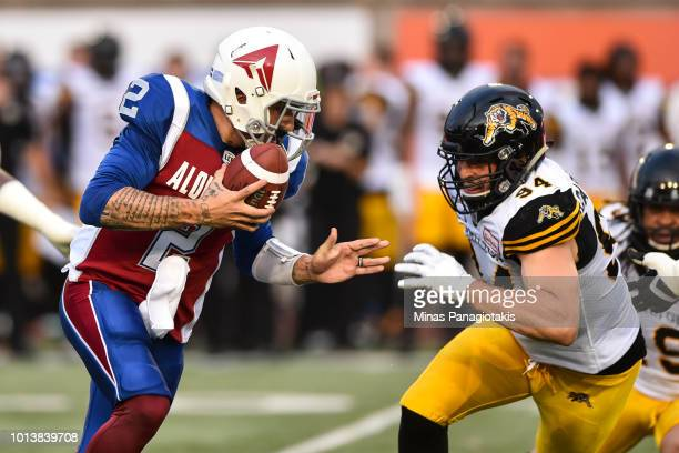 Quarterback Johnny Manziel of the Montreal Alouettes defends the ball from defensive end Justin Capicciotti of the Hamilton TigerCats during the CFL...