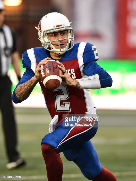 Quarterback Johnny Manziel of the Montreal Alouettes looks to play the ball against the Hamilton TigerCats during the CFL game at Percival Molson...