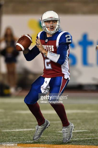 Quarterback Johnny Manziel of the Montreal Alouettes prepares to play the ball against the Hamilton TigerCats during the CFL game at Percival Molson...