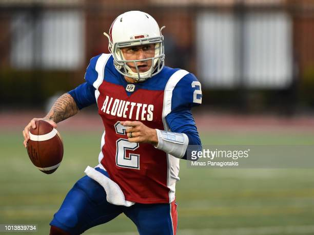 Quarterback Johnny Manziel of the Montreal Alouettes runs with the ball against the Hamilton TigerCats during the CFL game at Percival Molson Stadium...