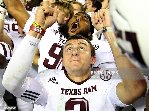 Quarterback Johnny Manziel of the Texas AM Aggies celebrates after the game against the Alabama Crimson Tide at BryantDenny Stadium on November 10...