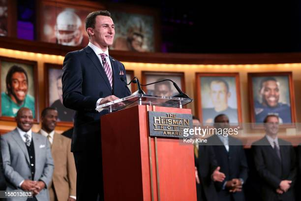 Quarterback Johnny Manziel of the Texas AM University Aggies poses with the Heisman Memorial Trophy after being named the 78th Heisman Memorial...