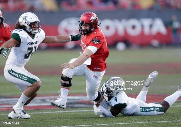 UNLV quarterback Johnny Stanton breaks a tackle during a game against Hawaii on November 04 at Sam Boyd Stadium in Las Vegas Nevada The UNLV Rebels...