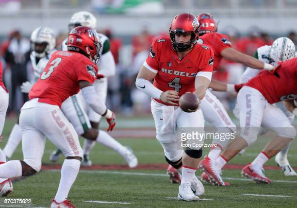 UNLV quarterback Johnny Stanton looks to hand off the football during a game against Hawaii on November 04 at Sam Boyd Stadium in Las Vegas Nevada...
