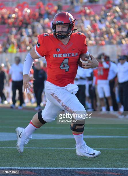 Quarterback Johnny Stanton of the UNLV Rebels runs for a touchdown against the Hawaii Warriors during their game at Sam Boyd Stadium on November 4...