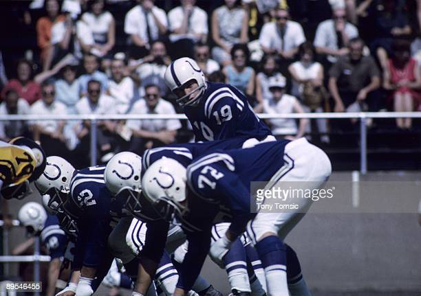 Quarterback Johnny Unitas of the Baltimore Colts calls out the signals at the line of scrimmage during the annual Hall of Fame game on September 6...