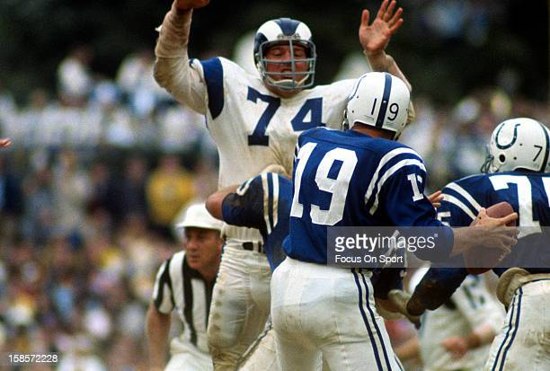 Quarterback Johnny Unitas of the Baltimore Colts drops back to pass against the Los Angeles Rams during an NFL football game circa 1967 at Memorial...